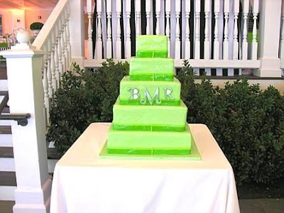 A five tier modern wedding cake mirrors the wedding 39s color scheme and