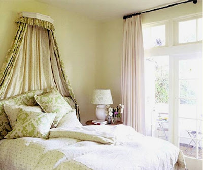 http://3.bp.blogspot.com/_6RuB-MyU_O4/SYarRQ81urI/AAAAAAAAENU/CzxnbLFU9gA/s800/kathryn+ireland+bedroom+coronet+crown+canopy+green+floral+french+doors+bed+pillows+traditional.jpg