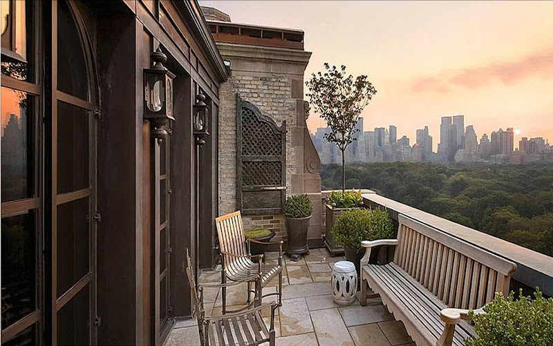 Balcony of a New York City apartment designed by Katie Leede with a view of Central Park