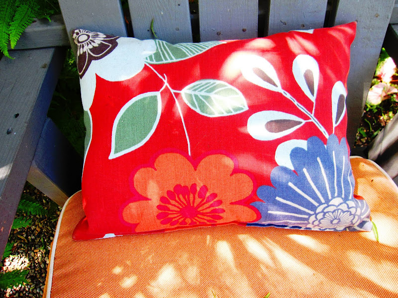 Close up of bright accent pillows on outdoor chairs in a backyard in Venice Beach, CA