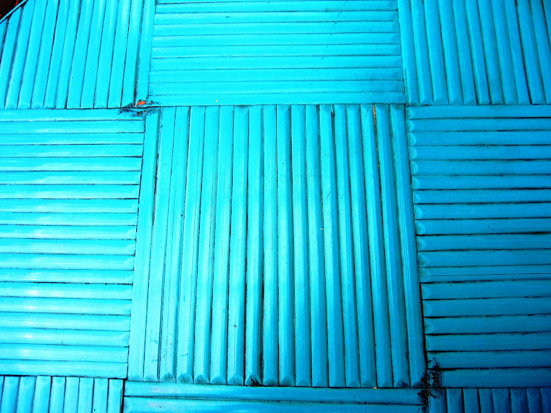 Close up of a turquoise blue rattan dining set