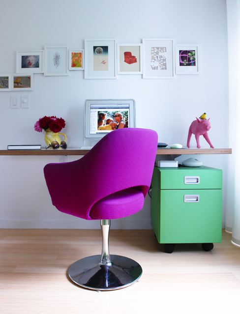 Interior designer Ghislaine Vinas' small home office with a bright purple Saarinen chair, floating desk and a green cabinet