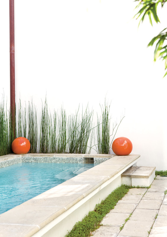 Two huge orange balls flank the lap pool in a Florida beach house