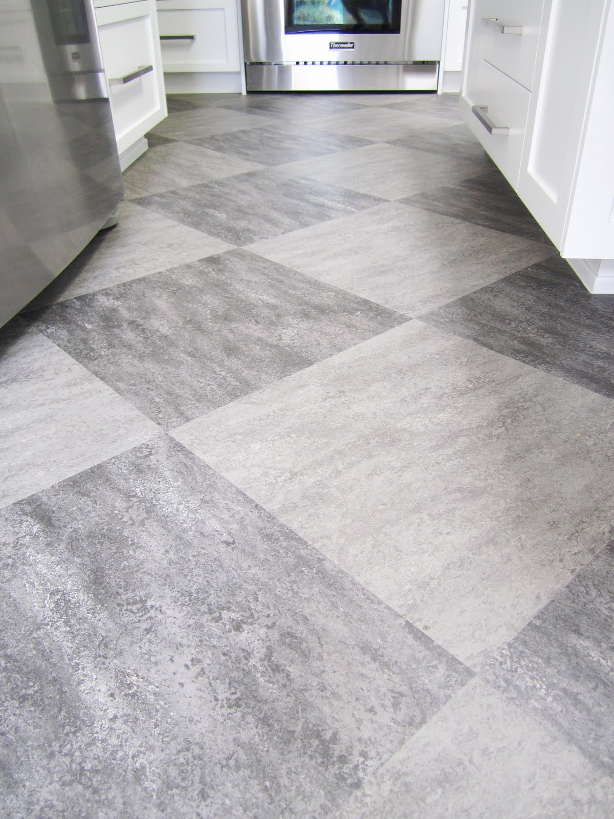 Harlequin Of Grey On Grey Tiles Is Used On The Kitchen Floor