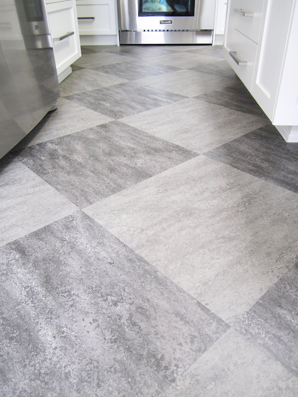 Grey Marmoleum tile floor arranged in a diagonal pattern in a kitchen