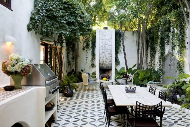 Outdoor Courtyard With Tile Floor Grand Modern Silver Fountain A Lounge Area And Dining