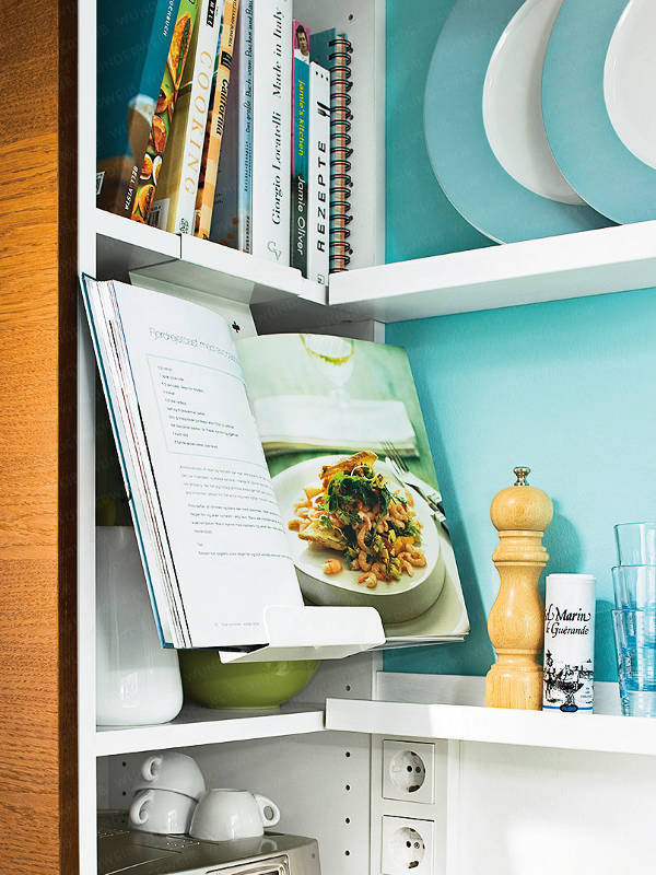 Floating shelves in a small turquoise kitchen with matching kitchen accessories