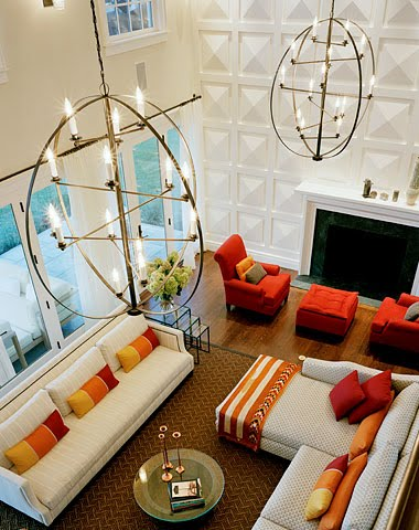 Two Story Living Room With Raised Pyramid Paneling And Modern Chandeliers
