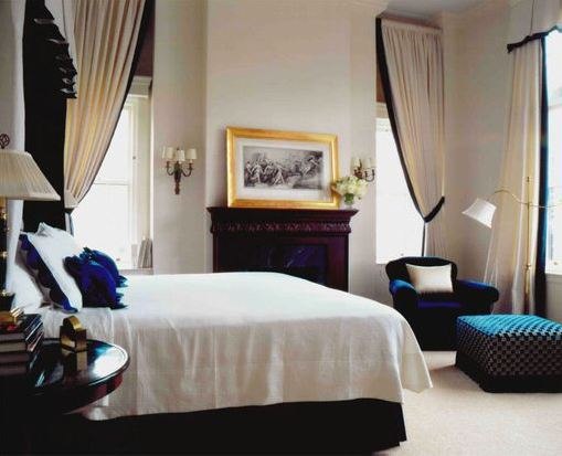 royal blue and black bedroom bedroom with a fireplace