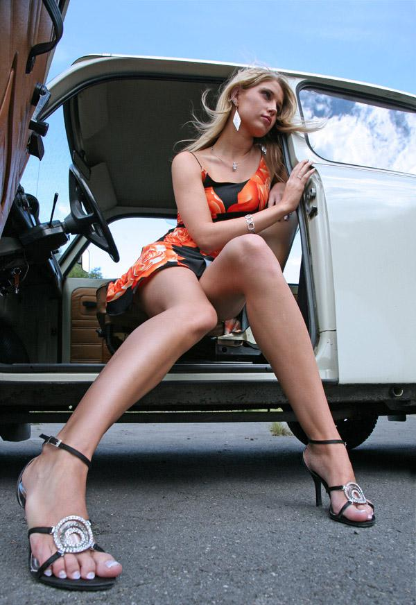 sexy girls posing with cars