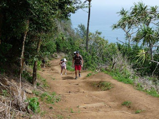 Pololu Valley hikers return from valley