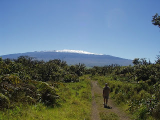 Keoki walking White Rd trail enjoying Mauna Kea viewes