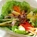 Salade Nioise (Vegetable salad Provenale, garnished with tuna, anchovies and egg)