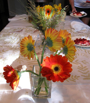 Divasofthedirt,gerber daisies on table