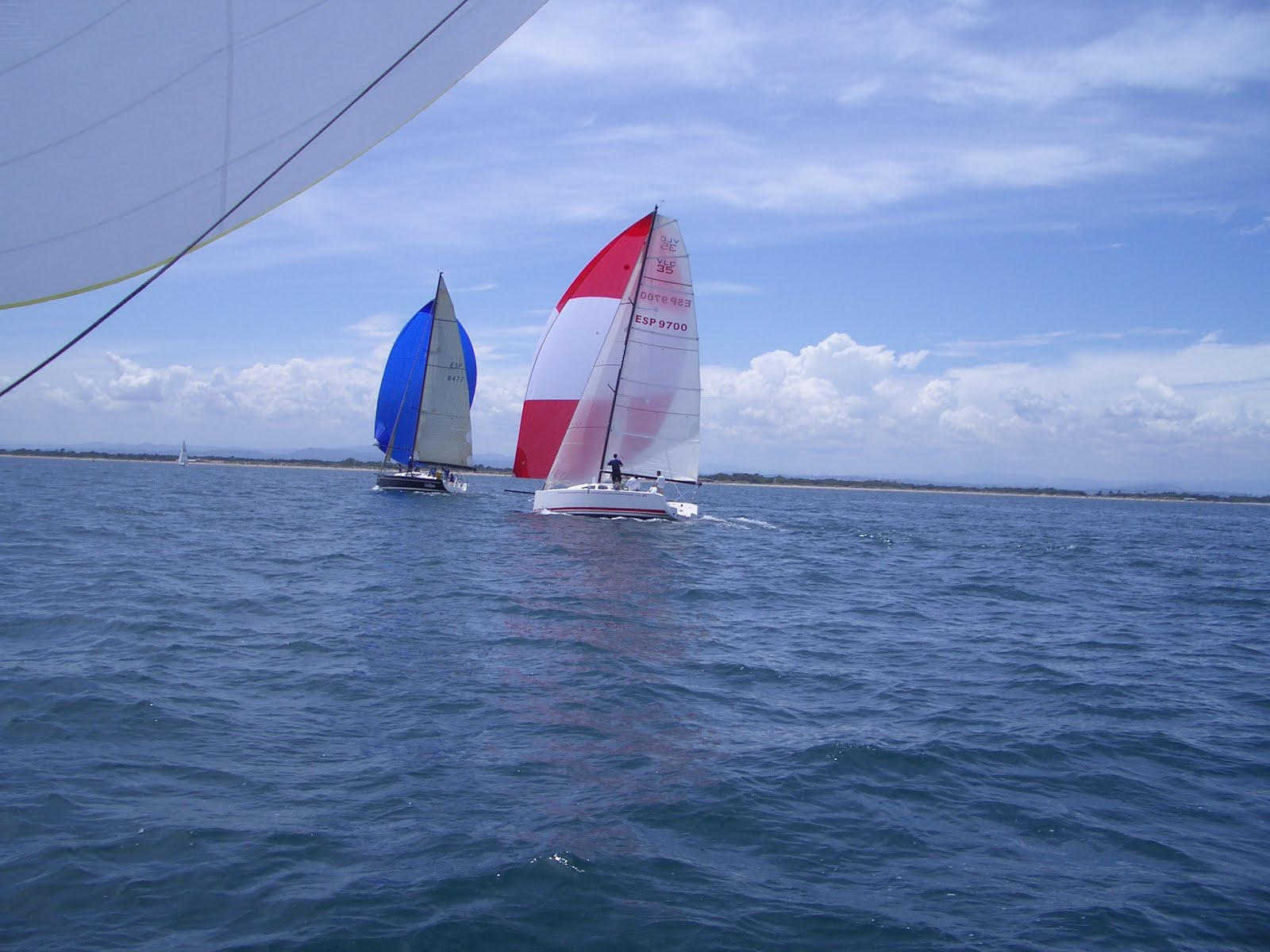 VLC 35 (foreground) going past a Dehler 44 downwind.