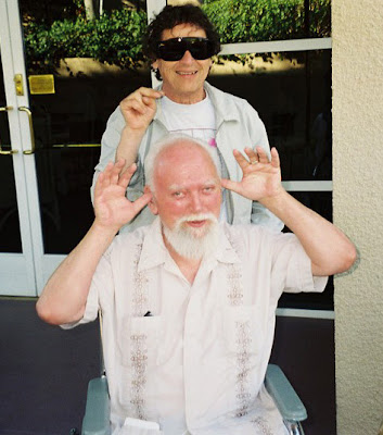 Bob (in wheelchair) clowning with Paul Krassner at the Prophets' Con 2000