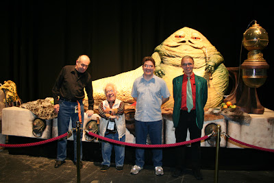 John Coppinger (sculptor), Mike Edmonds (tail), Dave Barclay (chief puppeteer), Toby Philpott (left hand man and tongue)
