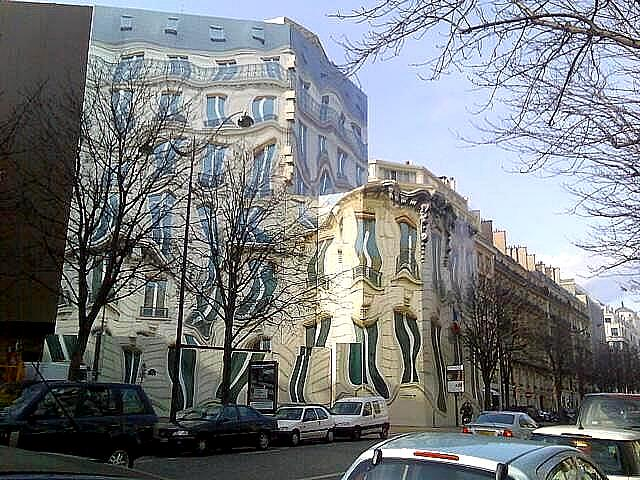 This surreal building actually exists at 39 Avenue George V, Paris.