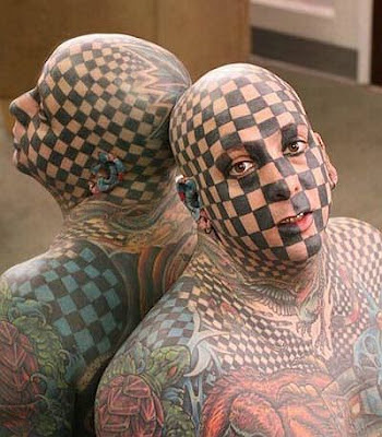 disturbed tattoo. full-face tribal tattoo.