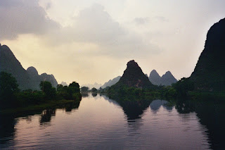 Limestone Karsts reflecting off the lake in Yang Shuo at Twilight.