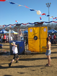 Kid throwing at the Dunk Tank