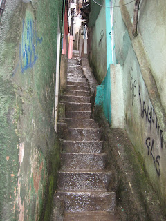Water running down narrow steps within the favela.