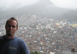 The view of the other side of the valley that the favela wraps across.  The newer section can be seen near the top.