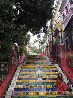 Woman in red dress on mosiac tile stairs in Lapa.