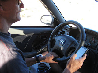 Chad on the drive out to the Colorado River.  You guys are awesome... except you... with the texting, I am watching you!
