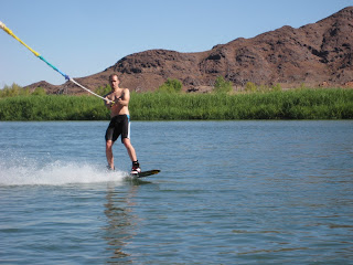 Noah wakeboarding while the water is still flat in the morning.
