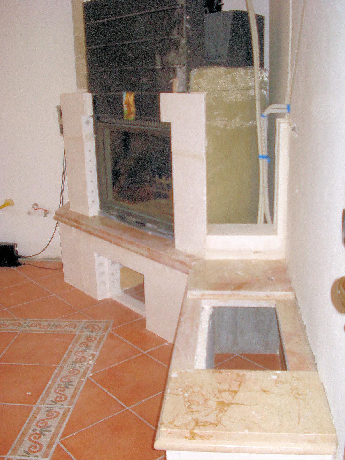 CLAUDIO CARUSO DECORAZIONI: Rivestimento termocamino: applicazione intonaco stampato effetto pietra
