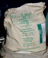 Bag of Mason's dry lime mortar mix.