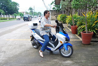 Dave Dewbre on 3000 watt electric motorcycle in Puerto Princesa Palawan. A demo model to show Mayor Ed Hagedorn