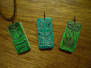 Three of our green bone domino tiki pendants