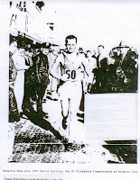 young Tom Osler waits at finish as Browning wins National AAU 30 K Championship in 1954 on the boardwalk in AC in front of the old Steel Pier