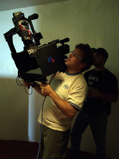 Twin-HDV camera rig for hand-held shooting