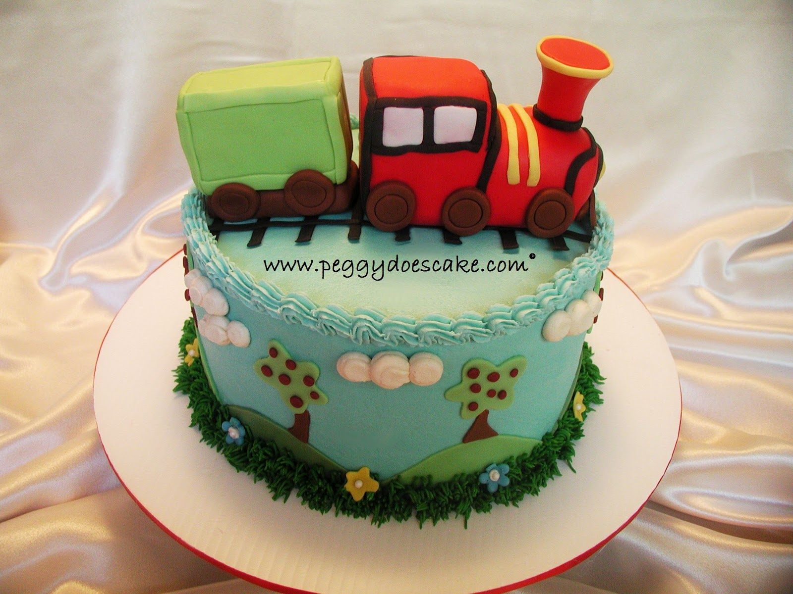 Peggy does cake james turned 2 with a choo choo cake click almond sour cream torted and filled with whipped vanilla bean buttercream everything on the cake is completely edible happy birthday little james altavistaventures Image collections