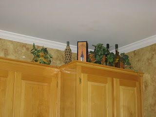 kitchen cabinet greenery wine bottles decor