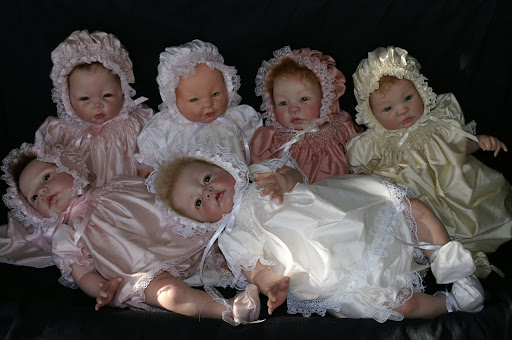 Reborn dolls and custom made smocked clothes by Judith