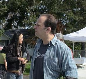 Mark Flanders and his wife Audrey Tsui chat with shoppers at the Ferndale Farmers Market