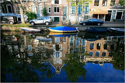 Amsterdam typical houses along canal with reflection