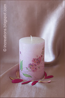 Decoupage candle with pink flowers