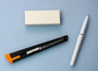 Pen, eraser and knife