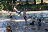 scouts on a rope bridge falling into water