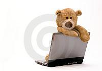 teddy bear on lap topp
