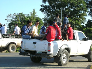 People loaded in pickup, La Ceiba, Honduras