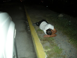 drunk man sleeping it off by the road