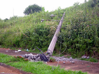 downed telephone pole, La Ceiba, Honduras