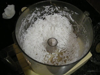 grating coconut in the Cuisinart, La Ceiba, Honduras