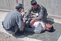 Students with the ANP Trauma Assistance Personnel course treat a fellow policeman's simulated wounds during the inaugural course at the ANP Central Training Center in Kabul, Afghanistan. 4.3.08